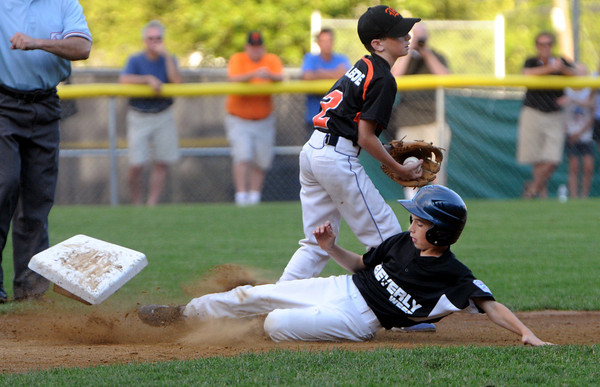 Beverly:<br /> Beverly West's Matthew Rawding slides into second base and sent the base flying but was out with Beverly East's Jon Gilbride covering second during the Beverly West vs. Beverly East in District 15 Little League Williamsport all-star game at Harry Ball Field.<br /> Photo by Ken Yuszkus/Salem News, Monday, July 2,  2012.