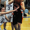 Wilmington:<br /> Ipswich's Brigid O'Flynn wrestled the ball away from a Stoneham player and shoots for the basket at the Ipswich vs Stoneham girls basketball game in the Division 3 North semifinals at Wilmington High School.<br /> Photo by Ken Yuszkus/Salem News, Thursday March 10, 2011.