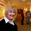 Salem:<br /> Curator Nancy Ferguson stands in the hallway which is lined with framed art from various artists at Grosvenor Park Nursing Center.<br /> Photo by Ken Yuszkus/Salem News, Monday November 16, 2009.