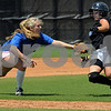 Lynn:<br /> North's third baseman #8,Meghan McNichol, tags out South's #5,Olivia Fontero, as she gets ready to slide into third base during the Agganis softball game at Fraser Field.<br /> Photo by Ken Yuszkus/Salem News, Sunday, July 12, 2009.