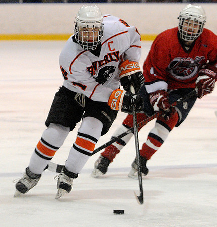 Salem:<br /> Beverly's Mitch Hamor controls the puck with a Lynn player right behind him during the Beverly vs Lynn boys hockey game at Salem State University.<br /> Photo by Ken Yuszkus/Salem News, Thursday, February 24, 2011.