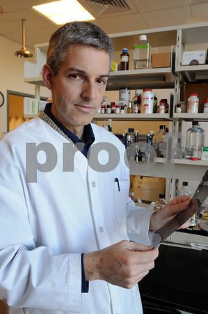 Wenham:<br /> Craig Story, assistant professor of biology at Gordon College, in the new Ken Olson Science Center.<br /> Photo by Ken Yuszkus/Salem News, Monday November 18, 2008.