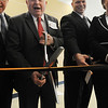 Beverly:<br /> William Scanlon, Jr., Beverly mayor, gets ready to cut the ribbon during the ribbon cutting ceremony for the new Beverly High School on Friday morning. To the right is Sean Gallagher, Beverly High School principal.<br /> Photo by Ken Yuszkus/Salem News,  Friday,  November 19, 2010.