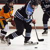 Peabody:<br /> Bishop Fenwick's Alex Pagano, left, tries to wrestle the puck from Peabody's Laura Miele during the Bishop Fenwick at Peabody girls hockey game at the McVann O'Keefe Rink.<br /> Photo by Ken Yuszkus/Salem News, Monday, December 26, 2011.