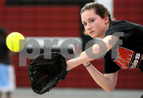 Salem:<br /> Ashley White catches the ball during the Salem High softball practice.<br /> Photo by Ken Yuszkus/Salem News, Tuesday, April 14, 2009.