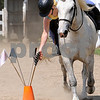 Topsfield:<br /> Page Koning reaches for a flag as she practices while riding Tucker. She is part of a group of kids from the Topsfield 4-H club that is going to a national relay competition in Virginia. <br /> Photo by Ken Yuszkus/Salem News, Friday, July 17, 2009.