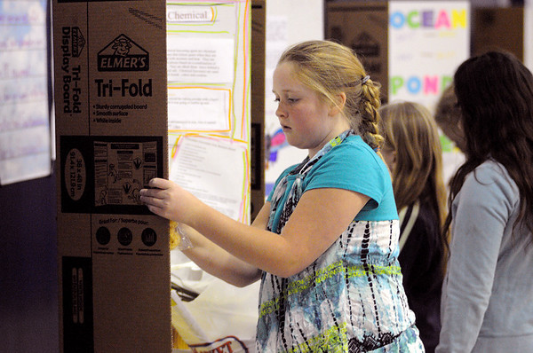 Beverly:<br /> Jessica Hall, fifth grader, puts finishing touches on her science project, Magical Leaving Agents, at the start of the 1st Annual Science Fair at Hannah School in Beverly.<br /> Photo by Ken Yuszkus/Salem News, Tuesday, April 12, 2011.