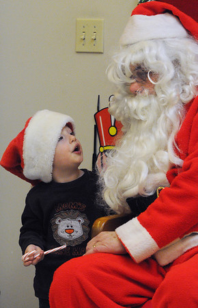 Peabody:<br /> Max LaSpina, 2 1/2, tells Santa what he would like for Christmas. Santa arrived at the Peabody Institute Library South Branch after a pancake breakfast was served Wednesday morning.<br /> Photo by Ken Yuszkus/Salem News, Wednesday, December , 2011.