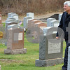 Beverly:<br /> Beverly Patrolman Gene Bettencourt walks through St. Mary's Cemetery in the area where a coyote was spotted. He drove his cruiser between a woman and a coyote that he said was about to attack her.  <br /> Photo by Ken Yuszkus/Salem News, Wednesday November 26, 2008.