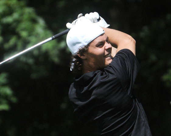 Middleton:<br /> Tuukka Rask on the 15th tee during Boston Bruins player Shawn Thornton's third annual Putts and Punches for Parkinson's golf tournament held at Ferncroft Country Club.<br /> Photo by Ken Yuszkus/Salem News, Monday, August 6,  2012.