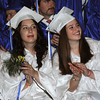 Beverly:<br /> Graduates from left, Taylor Bonini, Mikaela Bialecki, and Eleanor Benett applaud Savannah Hartigan who is one of two of the student speakers at the Landmark School graduation.<br /> Photo by Ken Yuszkus/Salem News, Friday, June1, 2012.