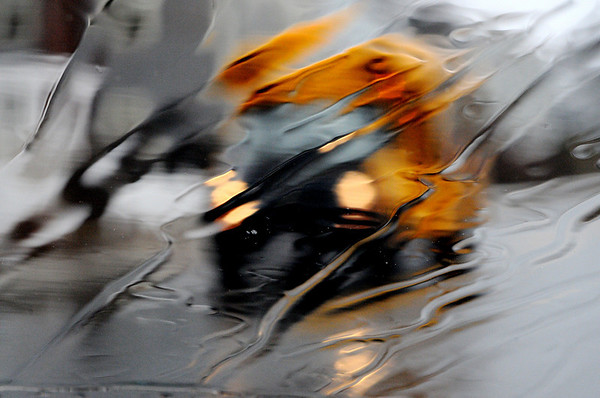 Beverly:<br /> The wind driven rain on the car windshield distorts the image of the school bus that is driving along Lothrop Street. Percipitation will continue for most of this week.<br /> Photo by Ken Yuszkus/Salem News, Wednesday, February 24, 2010.