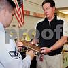 "Salem:<br /> U.S. Airforce Sgt. Steve Grant, left, gives the ""Airforce Outstanding Teacher Award for Tech Education"" to Salem High shop teacher Kenneth Wilson. <br /> Photo by ken Yuszkus/Salem News, Thursday June 18, 2009."