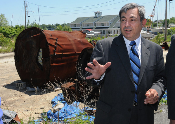 Danvers:<br /> Danvers Rep. Ted Speliotis speaks at the site of the Danversport explosion before going on a tour of the affected neighborhood.<br /> Photo by Ken Yuszkus/Salem News, Monday, June 6, 2011.