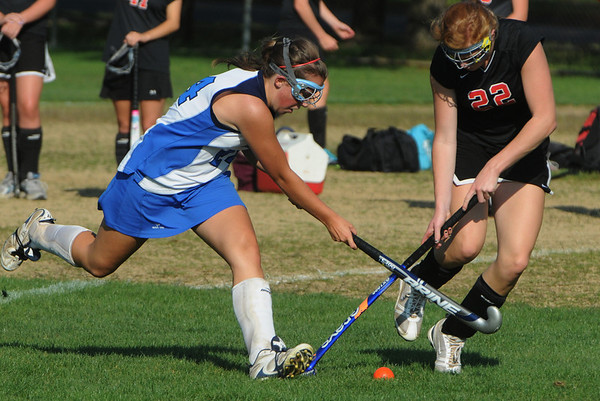 Danvers:<br /> Danvers' Rachel Trocchi, left, and Marblehead's Tyler Phillips fight for possession of the ball at the Marblehead at Danvers High School field hockey game.<br /> Photo by Ken Yuszkus/Salem News, Monday, September 12, 2011.
