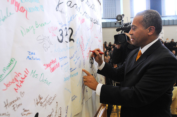 Salem:<br /> Gov. Patrick signs his name on a anti-bullying sign at the Collins Middle School. Gov. Patrick was attending the anti-bullying program at the school on Wednesday afternoon.<br /> Photo by Ken Yuszkus/Salem News, Wednesday, January 25, 2012.
