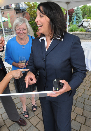 Danvers:<br /> Salem Mayor Kim Driscoll, right, gets a laugh after looking at an old photo of Nelson Benton at Nelson Benton's retirement party which was held at the Danvers Yatch Club. Left is Diane Pabich owner of the Salem Inn.<br /> Photo by Ken Yuszkus/Salem News, Wednesday, June 27,  2012.