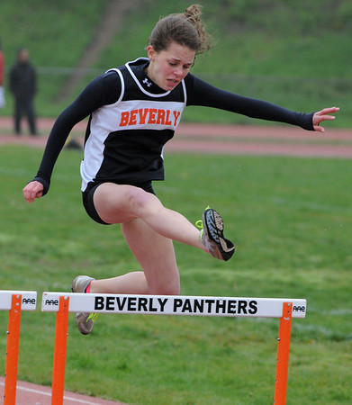 Beverly:<br /> Beverly's Allison Collins jumps over her final hurdle and wins her heat in the girls 400 yard hurdles during the Salem at Beverly track meet.<br /> Photo by Ken Yuszkus/Salem News, Tuesday, May 17, 2011.