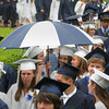 Wenham:<br /> Graduates under the umbrella from left, Kathryn McGlynn, Samantha Gabrielli, and Christine McLean are protected from the light rain and wind during the procession into the Gordon College Chapel to start the Hamilton-Wenham Regional High School graduation held at Gordon College.<br /> Photo by Ken Yuszkus/Salem News, Sunday, June 3, 2012.