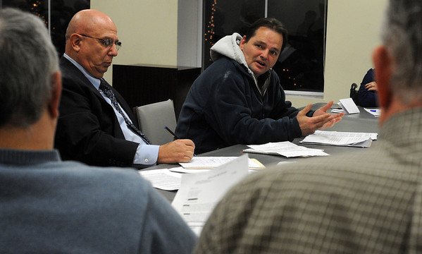 Salem:<br /> Chris Ducas, left, attorney, sits next to his client, Paul Dacey, during the hearing on Hilltop Manor.<br /> Photo by Ken Yuszkus/Salem News, Monday, February 13, 2012.