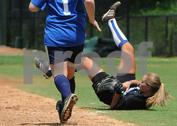 Lynn:<br /> South's first baseman #12, Emily Olson, fumbles with the ball after going for a pop fly by North's #1, Annie Abber, who is running to first during the Agganis softball game at Fraser Field. It was ruled as not an out.<br /> Photo by Ken Yuszkus/Salem News, Sunday, July 12, 2009.