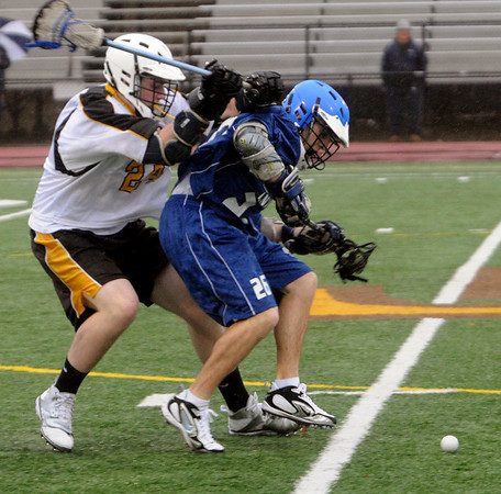 Danvers:<br /> Bishop Fenwick #24, left, pressures Danvers #26 as they both go for the ball at the Danvers at Bishop Fenwick boys lacrosse game.<br /> Photo by Ken Yuszkus/Salem News, Tuesday,March 30, 2010.