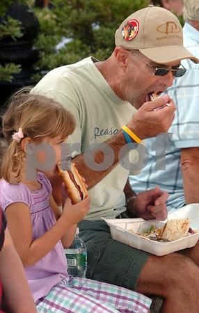 Peabody:<br /> Ashley Milne dines on a hotdog and her father Dana Milne tries a gyro at Peabody's 26th annual International Festival.<br /> Photo by Ken Yuszkus/Salem News, Sunday, September 13, 2009.