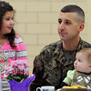 Peabody:<br /> Kylie Colella, third-grader at the Center Elementary School, has lunch at school with her father, David, brother, Mason, 7 months old, and her mother, Marie, not pictured. David Colella just returned from his tour of duty in Afghanistan.<br /> Photo by Ken Yuszkus/Salem News, Friday, January 27, 2012.