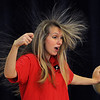 Wenham:<br /> Noelle Perry, from the Museum of Science, demonstrated the effect of an electrical charge affecting her hair while she held onto the Van de Graaf generator. She presented her program on electromagnetism to the 3rd, 4th, and 5th graders at the Buker Elementary School on Wednesday morning.<br /> Photo by Ken Yuszkus/Salem News, Wednesday, November 2, 2011.