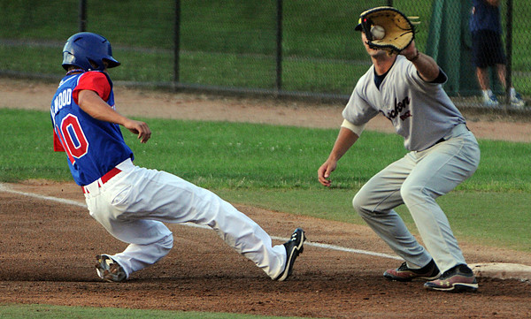 Lynn:<br /> North Shore Navigators' Brad Elwood gets back to first base safely in a pick off try from the pitcher to Brockton Rox's first baseman Nick Colucci during the Brockton Rox at North Shore Navigators baseball game held at Fraser Field.<br /> Photo by Ken Yuszkus/Salem News, Thursday, July 5,  2012.