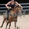 Topsfield:<br /> Brittany Taylor practices balancing a tennis ball on a tennis racquet while riding Winsome. She is part of a group of kids from the Topsfield 4-H club that is going to a national relay competition in Virginia. <br /> Photo by Ken Yuszkus/Salem News, Friday, July 17, 2009.