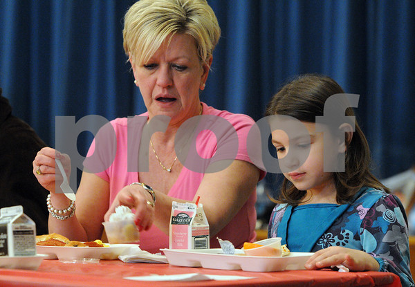 Peabody:<br /> Gretchen Habeeb of Revere, grandmother of Skyla Gallo, kindergartener at the Burke Elementary School, eat together in the school cafeteria during the Grandparent's Brunch.<br /> Photo by Ken Yuszkus/Salem News, Thursday,  February 12, 2009.