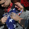 Beverly:<br /> Elizabeth Crawford, Stephen's mother received the flag that draped the casket of her son from Brigidier general Tom Semonite at the end of the graveside funeral service at St. Mary's Cemetery. Stephen R. Fortunato, was killed in Afghanistan by a roadside bomb.<br /> Photo by Ken Yuszkus/Salem News, Friday, October 24, 2008.
