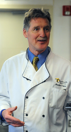 """Beverly:<br /> Chef Brendan Cronin is Irish and has written a memoir called """"Cheffin'--from potatoes to caviar"""".<br /> Photo by Ken Yuszkus/Salem News, Wednesday,  March 7, 2012."""