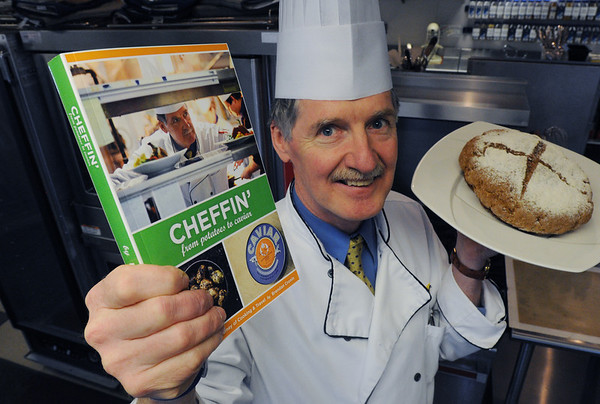"""Beverly:<br /> Chef Brendan Cronin is Irish and has written a memoir called """"Cheffin'--from potatoes to caviar"""". He is holding his book and """"My mother's Irish brown soda bread"""" which was created from his mother's recipe which is in his book.<br /> Photo by Ken Yuszkus/Salem News, Wednesday,  March 7, 2012."""