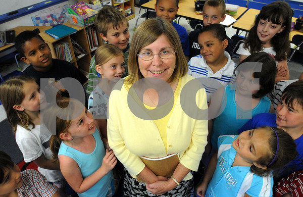 Salem:<br /> Dr. Peg Howard, principal of the Saltonstall School, is in her final few weeks before she retires. She is surrounded by the first and second graders in Miss Lopez' class.<br /> Photo by Ken Yuszkus/Salem News, Monday, July 13, 2009.