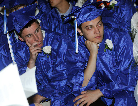 Beverly:<br /> Graduates Connor Bruce, left, and Derek Bowman listen to speakers during the Landmark School graduation.<br /> Photo by Ken Yuszkus/Salem News, Friday, June1, 2012.