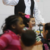 """Danvers:<br /> Casey Preston, an actor portraying Abraham Lincoln, directs students line dancing during his presentation, """"Abraham Lincoln: American President"""", at the Highlands Elementary School.<br /> Photo by Ken Yuszkus/Salem News, Tuesday, February 2, 2010."""
