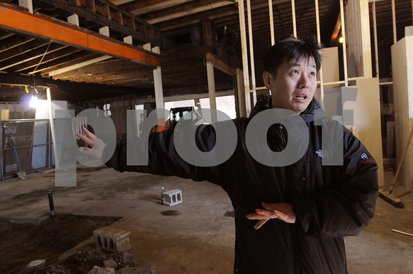 Beverly:<br /> D. W. Kim, owner of the U.S. Tae Kwon Do Center, which is moving down Cabot Street to the vacant former Town Paint & Supply Co. building, speaks about the new building under construction. <br /> Photo by Ken Yuszkus/Salem News, Tuesday,  January 21, 2009.
