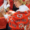 Peabody:<br /> Trudy Dearborn is dressed in Red Sox garb for the opening day pep rally festivities at the McIntosh Clubhouse at Brooksby Village held Thursday at noon. The rally featured Wally the Green Monster, Red Sox trivia contests, a contest for the five best Red Sox outfits and lots of cheering, singing, and Fenway Franks. <br /> Photo by Ken Yuszkus/Salem News, Thursday, April 7, 2011.