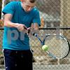 Danvers:<br /> Singles player Jeffrey Wheeler of the Danvers High boys tennis, practices at the Plains Park tennis courts.<br /> Photo by Ken Yuszkus/Salem News, Thursday, April 2, 2009.