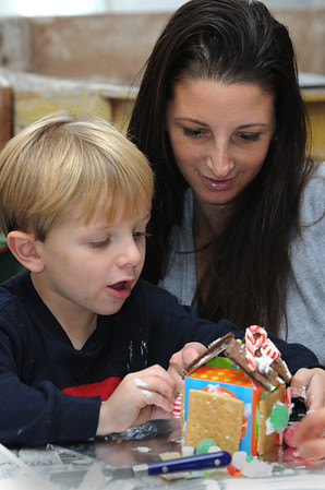 Marblehead:<br /> Hayden Gallo, 4, and his mother, Melissa Gallo, build a gingerbread house during the gingerbread house workshop at the Marblehead Museum. The two workshops are part of the Marblehead Christmas Walk. <br /> Photo by Ken Yuszkus/Salem News, Tuesday, November 29, 2011.