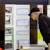 Beverly:<br /> Ken Obear, grandfather of one of the exhibitors, looks over science projects during the 1st Annual Science Fair at Hannah School in Beverly.<br /> Photo by Ken Yuszkus/Salem News, Tuesday, April 12, 2011.