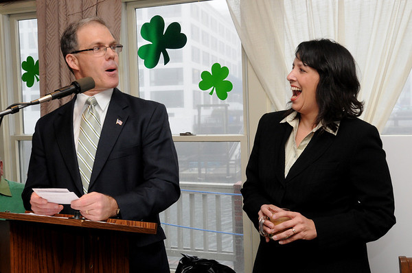 Salem:<br /> Rep. John Keenan and Salem Mayor Kim Driscoll jokingly exchange political jabs at each other at the podium during Rep. John Keenan's annual St. Patrick's Day breakfast held at Finz restaurant on Friday morning.<br /> Photo by Ken Yuszkus/Salem News, Friday, March 11, 2011.