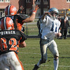 Ipswich:<br /> Hamilton-Wenham's Luke Wendt lets the ball fly under pressure from Ipswich during the Hamilton-Wenham at Ipswich football game on Thanksgiving Day.<br /> Photo by Ken Yuszkus/Salem News, Thursday, November 24, 2011.