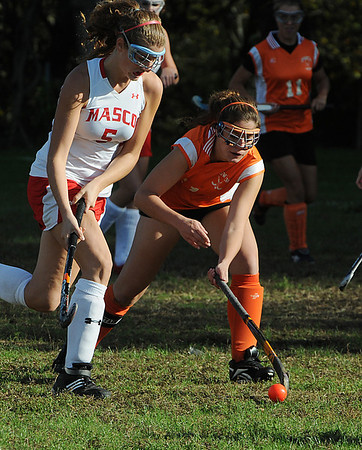 Boxford:<br /> Masconomet's Brooke Stewart, left, and Ipswich's Mary Markos, battle over the ball at the Ipswich at Masconomet field hockey game.<br /> Photo by Ken Yuszkus/Salem News, Thursday, October 7, 2010.