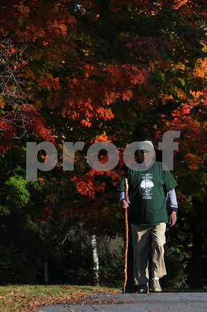 Wenham:<br /> Bill Dupee walks the streets of Wenham and Hamilton in his quest to walk every street in the two towns. He is walking on Fiske Road.<br /> Photo by Ken Yuszkus/Salem News, Wednesday, October 15, 2008.