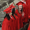 Salem:<br /> A graduates waves toward the audience during the processional at the beginning of Salem High School graduation.<br /> Photo by Ken Yuszkus/Salem News, Friday, June 3, 2011.