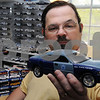 Danvers:<br /> George Corley holds his model of a Massachusetts state police cruiser which is part of his large collection of car models, Matchbox cars, and SciFi collectibles.<br /> Photo by Ken Yuszkus/Salem News, Thursday, April 30, 2009.