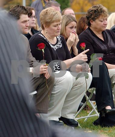 Danvers:<br /> Jewel Barnett, widow of Donald Barnett, Jr., center, holding a rose, listens to the memorial service for her husband, Donald Barnett, Jr., at Plains Park.<br /> Photo by Ken Yuszkus/Salem News, Friday, November 7, 2008.